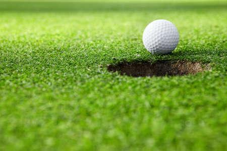 穴にゴルフ ・ ボール 写真素材