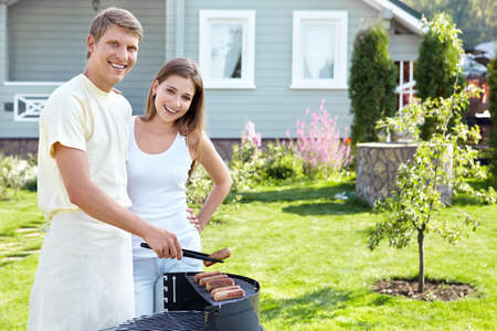 The happy couple makes barbecue photo
