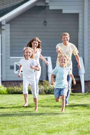 Running a family on the lawn photo