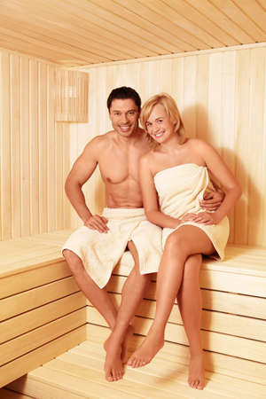 barefoot man: Young couple in sauna
