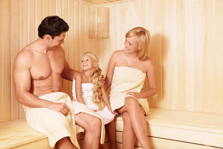 Happy family in the sauna photo