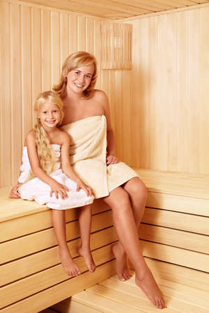 Mother and daughter in the sauna photo