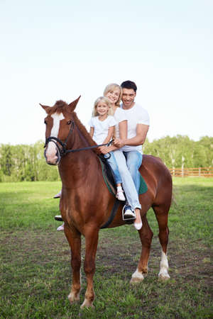 A family on a horse photo