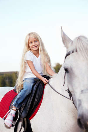 Little girl on a horse photo