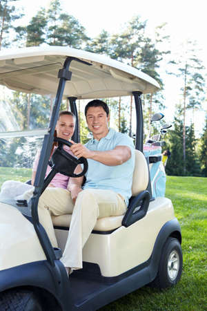 Couple in a golf car Stock Photo - 11124353