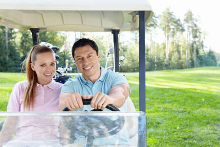 Couple in a golf car Stock Photo - 11124342