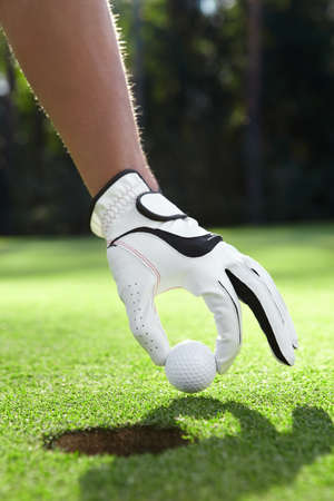 golf glove: Hand in glove puts the golf ball on the field