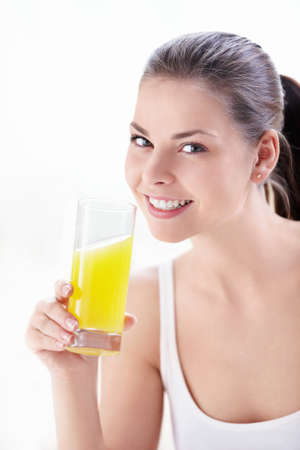females only: Young attractive girl with a glass of juice