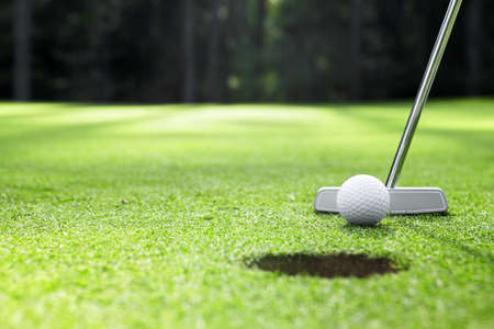 nearly: The ball at the hole on the golf course