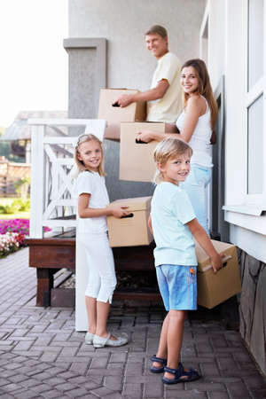 Family with boxes in the house photo