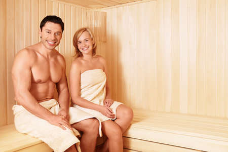 Young attractive couple in sauna photo