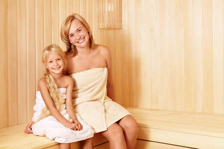 mother on bench: Mom and daughter in the sauna