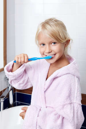 Girl brushing teeth in the bathroom Stock Photo - 11420283