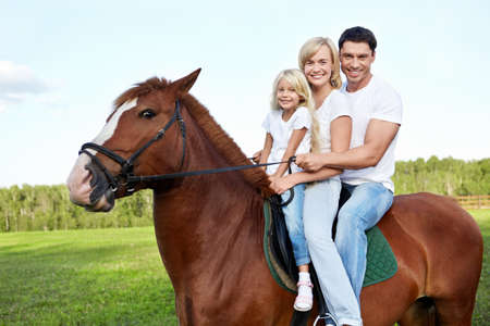 Family with daughter on a horse photo