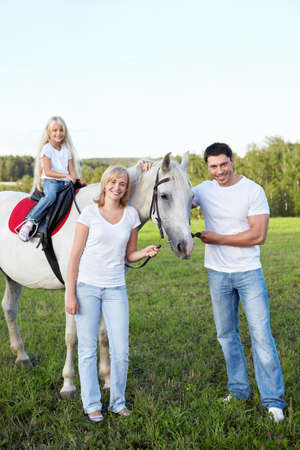 Family with a daughter with a horse photo