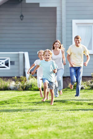 Running children and parents outdoors photo