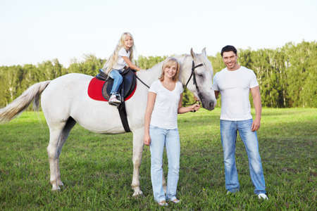 Attractive family with a horse photo