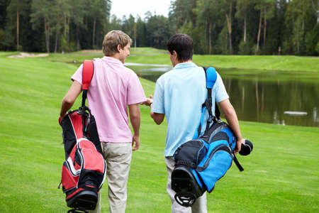 golfing: Two players on the golf course