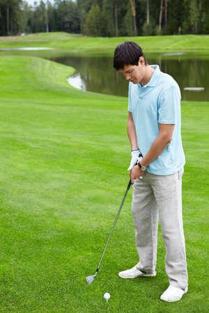 putter: A man playing golf