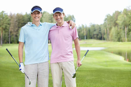 Two men golfers on the golf course photo
