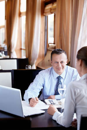 Businessman in a restaurant in negotiation Stock Photo - 11698774