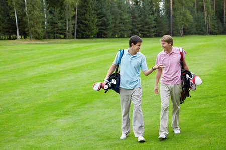 Talking golfers on the golf course Stock Photo - 11699038