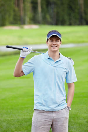 Happy Golfer on the golf course photo