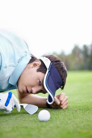 golf glove: A young man playing golf