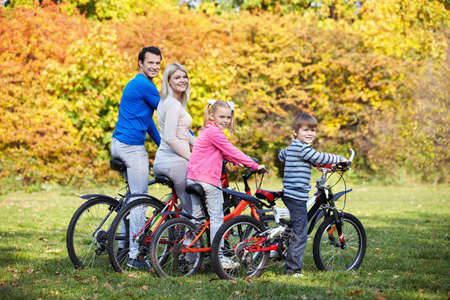 Family on bikes in the park Stock Photo - 11989484