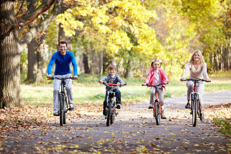 outdoor sports: Family on bikes in the park Stock Photo