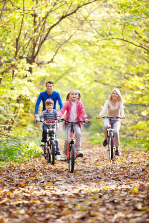 Family on bikes in the park Stock Photo - 11989471