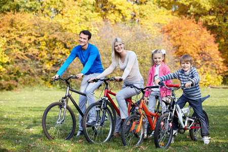Young family on bicycles photo