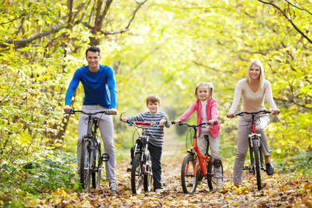 autumn family: Families with children on bicycles