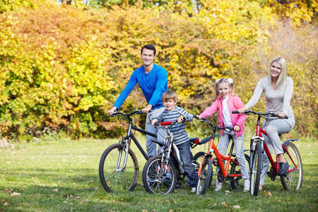 family fall: Family on bikes in the park Stock Photo