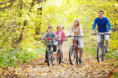 family activities: Family on bikes in the park Stock Photo