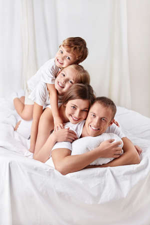 Happy family in the bedroom photo