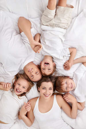family indoors: Happy family with children in bed