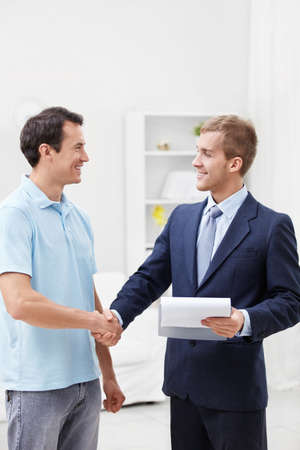 shakes hands: The consultant shakes hands with a man