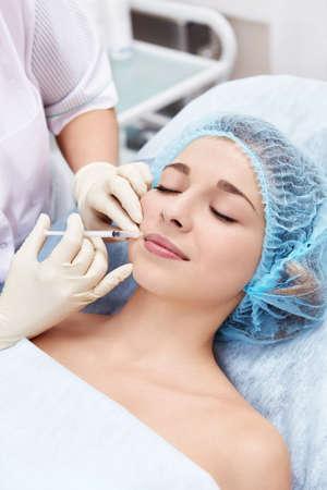 inject: Inject Botox beautiful girl Stock Photo