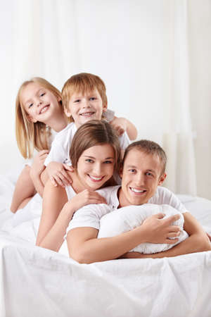 Smiling family in the bedroom photo