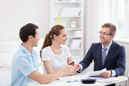 financial consultants: A man gives a credit card consultant
