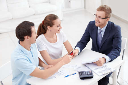banking document: A man gives a credit card consultant