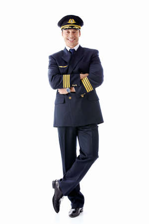 captain: A man dressed as a pilot on a white background Stock Photo