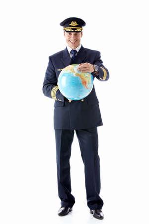Un hombre vestido como un piloto con un globo terr�queo sobre un fondo blanco Foto de archivo - 12773241