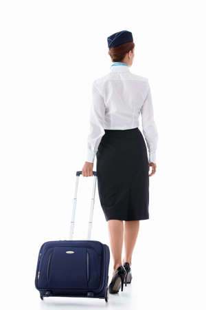 stewardess: Stewardess with a suitcase on a white background