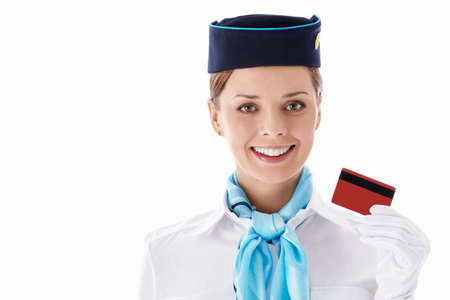 Stewardess with a credit card on a white background photo