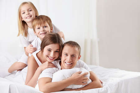 Families with children in the bedroom Stock Photo - 12773587