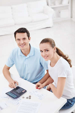 A young couple with money at home photo