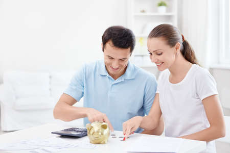 Young couple counts money photo