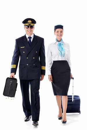The pilot and stewardess on a white background photo